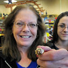 "Newburyport: Port Wine and Spirits employees Diane Torpey, left, her daughter Barbara Pesa, and Jesse Speed (out of photo) are trying to find the owner of this Newburyport High class of 1933 ring. Initials inside the women's ring are ""BP"" and going through an old yearbook the only female name that match are that of Priscilla Bradford. Bryan Eaton/Staff Photo"