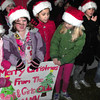 Salisbury: Children from the Boys and Girls Club in Salisbury braved the cold and windy weather to sing Christmas carols in the neighborhood on Wednesday night. Afterwards they headed to a board of directors meeting and surprised them with some singing as well. Bryan Eaton/Staff Photo
