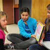"Amesbury: Amesbury Middle Schooler Hanna Scotch, 11, center, reads her book ""Why Was the Discovery of King Tut's Tomb Important"" with classmate Ashley York, 12, to Peyton Searles, 8, at the Cashman School in Amesbury. The sixth-graders have been learning about ancient Egypt in their language arts and social studies classes and traveled to the Cashman School to read thier informational books to them. Bryan Eaton/Staff Photo"
