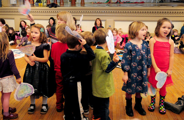 "Newburyport: Children sing ""Put a Little Love in Your Heart"" upstairs at Newburyport City Hall on Wednesday morning. One of several presentations for the annual Peace Gathering put on the by the Newburyport and Inn Street Montessori Schools. Bryan Eaton/Staff Photo"
