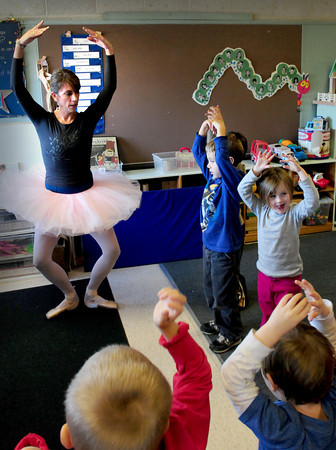 Amesbury: Amesbury Elementary School fourth grade teacher Cristin Chabot shows the basics of ballet in Maryann Dower's pre-kindergarten class Thursday afternoon. Chabot once played the Sugar Plum Fairy in the Nutcracker, which the children were learning about, and once taught ballet. Bryan Eaton/Staff Photo