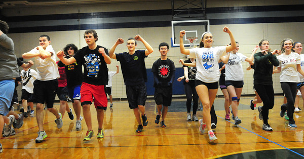 Byfield: The Triton High School indoor boys and girls track team practice together as they have been merged together under one coach, Joe Colbert. Bryan Eaton/Staff Photo