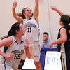 Georgetown: Georgetown's Kristin Hogan jumps for a three-pointer to get her 1000th point. Bryan Eaton/Staff Photo