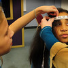 "Salisbury: Abigail Davis, 12, left and sewing instructor Rowan Andriotakis measure Safia Herqaoui, 8, for a costume in the upcoming play ""Beauty and the Beast"" at the Boys and Girls Club on Monday. The two youngsters are also in the new sewing program which is making the costumes for the play. Bryan Eaton/ Staff Photo"