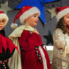 "Amesbury: Children at the Cashman Elementary School in Amesbury presented the play ""Shapin' Up Santa"" for the school body on Tuesday and for parents later that night. Santa, played by Jessse Gwynn, center, is being dropped off at Betty Body's Health Haven to lose weight--as he got stuck in the chimney last year--by Mattew Anderson, as Hughie the Elf, and Hannah Gale, as Mrs. Claus. Bryan Eaton/Staff Photo"