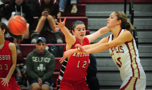 Newburyport: Amesbury's Reid Megan tries to block a pass from Newburyport's Emily Pettigrew. Bryan Eaton/Staff Photo
