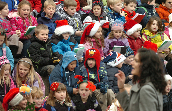 Amesbury: Amesbury Elementary School music teacher Alicia Harlove leads students in Jingle Bells at the Upper Millyard amphitheater on Wednesday afternoon. Then entire school body performed as they do every year for family and friends. Bryan Eaton/Staff Photo