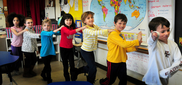 Newburyport: Students dance to some fast-paced Latin-type music in Janice Cahill's class at the Bresnahan School on Tuesday. The second-graders were getting a little excercise between their literacy studies before they moved on to math. Bryan Eaton/Staff Photo
