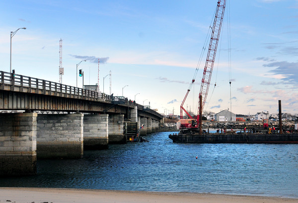 Hampton: A barge and crane were in place to remove an excavator used in the dredging of Seabrook Harbor that fell in the water last week after the barge it was on took on water causing the equipment to fall into the Hampton River under the bridge. Bryan Eaton/Staff Photo
