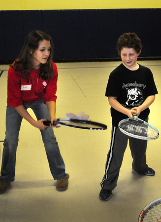 Amesbury: Olivia King goes through a drill with Solomon Browne, 8. Bryan Eaton/Staff Photo