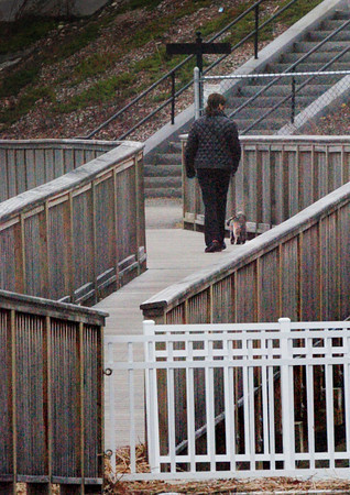 Newburyport: A lady walks her dog amongst the geometric shapes of the Newburyport Rail Trail and Harborwalk on an overcast Tuesday afternoon. Bryan Eaton/Staff Photo