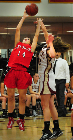Newburyport: Amesbury's Amanda Martin goes for shot as Newburyport's Emily Pettigrew covers. Bryan Eaton/Staff Photo