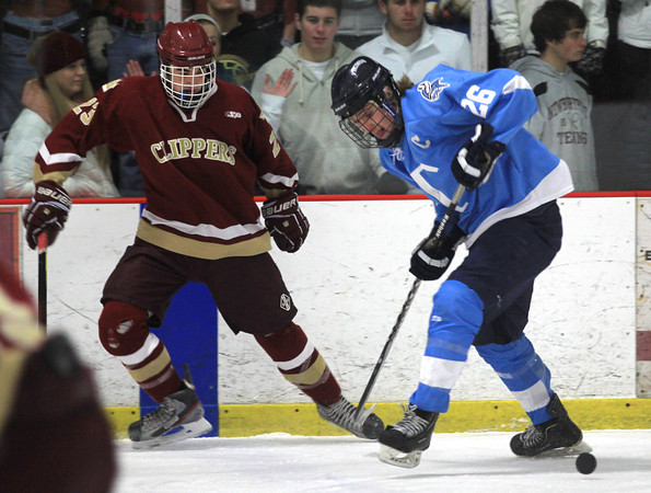 Newburyport: Newburyport's Matt Kelleher and Triton's Tucker Johnson fight for the puck during their game at the Graf Rink in Newburyport Sunday night. Jim Vaiknoras/staff photo