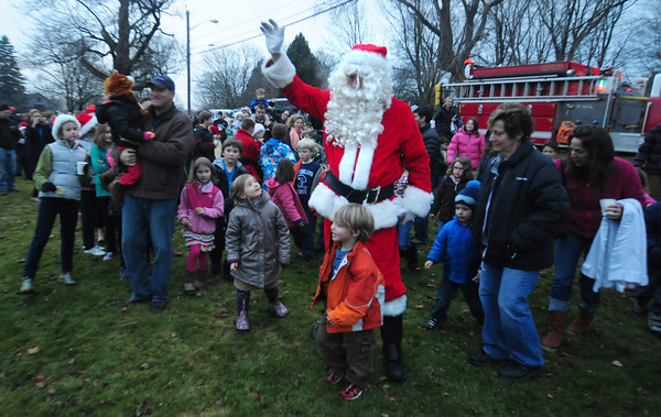 Newbury:Santa arrives  at the annual Tree Lighting on the Upper Green in Newbury Sunday night. Jim Vaiknoras/staff photo
