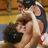 Byfield: Triton's Tom Howell pins Masco's Dan Grgoria during the 152lb match at Triton Wednesday. JIm Vaiknoras/staff photo