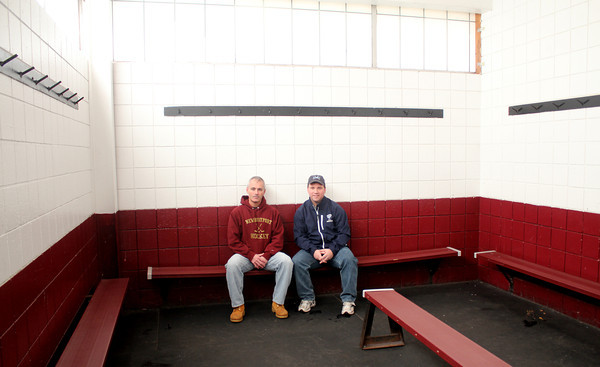 Newburyport: Newburyport high hockey coach Paul Yameen and Triton hockey coach Drew Wile sit in the locker room at the Graf Rink. The coaches want to renovate the locker rooms. Jim Vaiknoras/staff photo