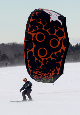 Amesbury: John DeSalvo kitesurfs in the high winds and cool weather at Woodsom Farm in Amesbury Sunday afternoon. JIm Vaiknoras/staff photo