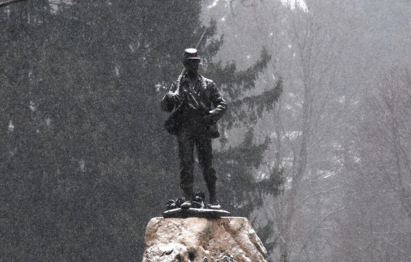 Newburyport: Snow falls Saturday on the Civil War Statue at Atkinson Common in Newburyport. Jim Vaiknoras/staff photo