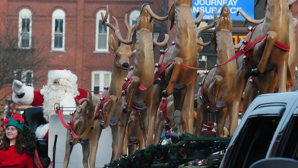 Merrimac: Santa waves to the crowd during the annual Merrimac santa Parade sunday. Jim Vaiknoras/staff photo