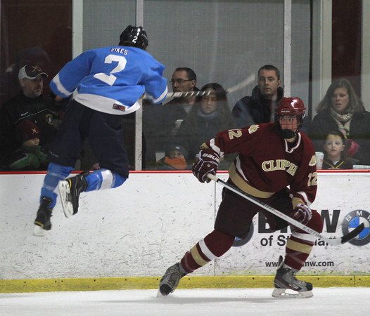 Newburyport: Newburyport's Austin Roy sends Triton's Derek Donley airborne during their game at the Graf Rink in Newburyport Sunday night. Jim Vaiknoras/staff photo