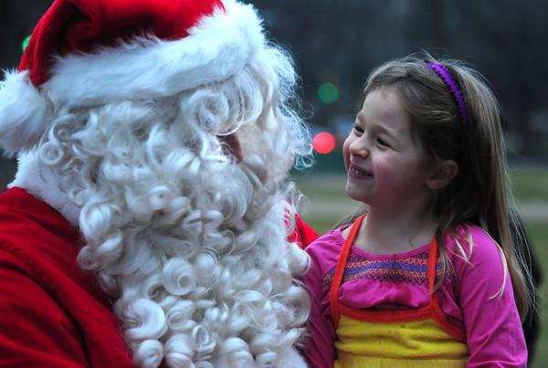 Newbury:Sophia Rully, 4, has a talk with Santa at the annual Tree Lighting on the Upper Green in Newbury Sunday night. Jim Vaiknoras/staff photo