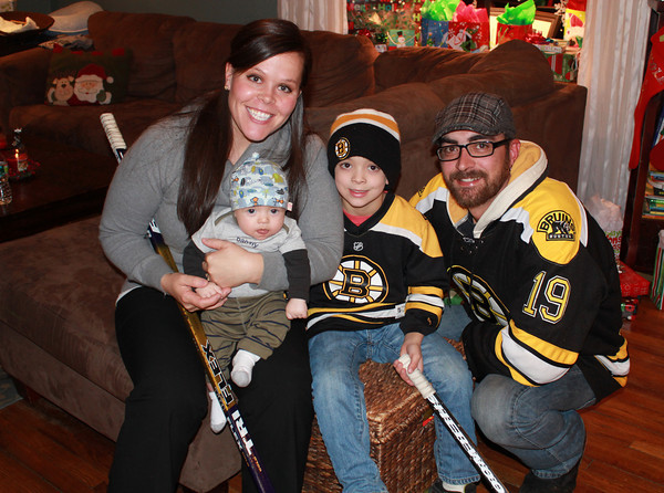 Amesbury: New Masconomet hockey coach Nicole Twomey with her husband Matt and her sons, Colin 5, and owen 12 weeks at their Amesbury home. Jim Vaiknoras/staff photo