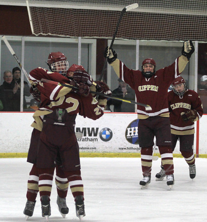 Newburyport: Newburyport player celebrate their first period goal against Triton during their game at the Graf Rink in Newburyport Sunday night. Jim Vaiknoras/staff photo