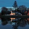 Newbury: The pond on the Upper Green in Newbury reflect Christmas lights on a calm Sunday evening. Jim Vaiknoras/staff photo