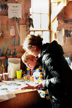 Amesbury:Finn Stinson, 4, and his mom Jennifer make ornaments and hand prints at the Lowell's Boat shop Open House Sunday. Jim Vaiknoras/staff photo