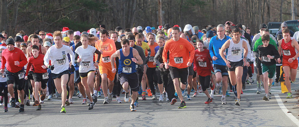 Merrimac: Runners take off in the 18th annual Winner's Circle Running Club Santa's Toy Trot at the Sweetsir School in Merrimac Sunday. Jim Vaiknoras/staff photo