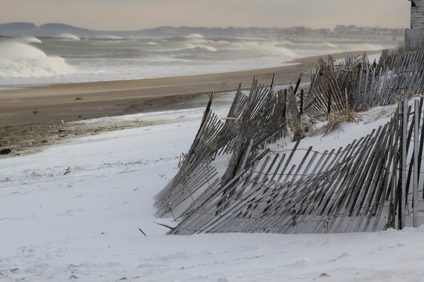 Salisbury: High surf pounds a snow covered Salisbury Beach Sunday afternoon. Jim Vaiknoras/staff photo