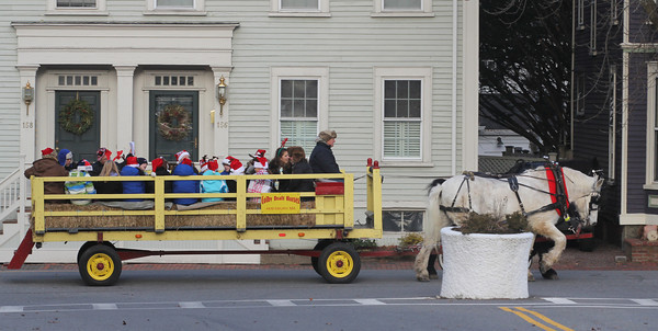 Newburyport: A hay ride pulled by Colby Draft Horses makes it's way down High Street as passengers sing holiday songs. Jim Vaiknoras/staff photo
