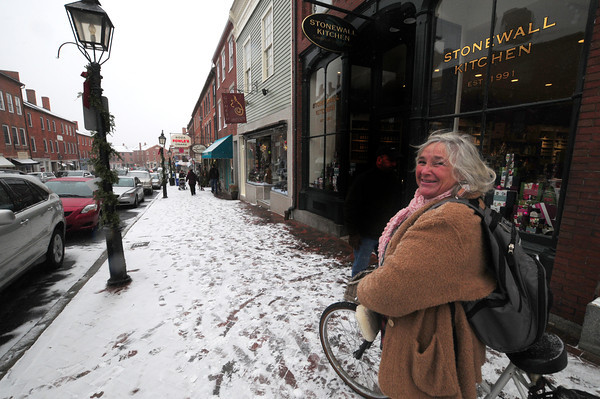 Newburyport: Oceanna walks her bike on State Street as a light snow falls on Newburyport Saturday. Jim Vaiknoras/staff photo