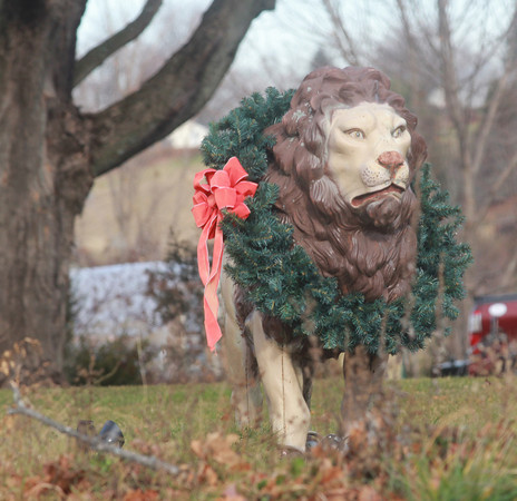 Amesbury: The lion statue on Lion's Mouth Road in Amesbury mane is encircled by a wreath. Jim Vaiknoras/staff photo