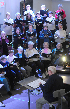 Newburyport:The Newburyport Choral Society under the direction of Gerald Weale rehearse at the Bellville Church in Newburyport. Jim Vaiknoras/Staff photo