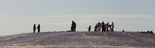 Amesbury: Sledders gather at Woodsom Farm as the sun sets Sunday afternoon. Jim Vaiknoras/staff photo