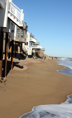 Newbury: The houses on Annapolis Way that are threatened by erosian as seen from the beach. The stairs that once were at sand level now sits 20 ft above the beach. Jim Vaiknoras/staff photo