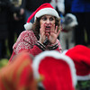 "Newbury:Music teacher Lori Peterson directs the Newbury Elemetary School choir in ""The Twelve Days of Christmas"" at the annual Tree Lighting on the Upper Green in Newbury Sunday night. Jim Vaiknoras/staff photo"
