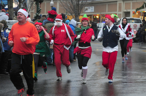 Amesbury: Runners get into the holiday spirit as they make their way though Market Square in Amesbury in The 2nd Annual Run Santa Run 1-Miler Saturday. Jim Vaiknoras/staff photo