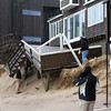 Newbury: Local residents inspect their homes for damage after Thursday's storm hit the structures along Annapolis Way on Plum Island particularly hard. Photo by Ben Laing/Staff Photo
