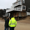 Newbury: Inspectors walk the beach along Annapolis Way on Plum Island Thursday afternoon, checking out the storm damage done to homes along the beachfront. Photo by Ben Laing/Staff Photo