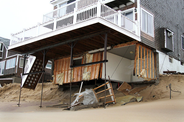 Newbury: A home along Annapolis Way on Plum Island was severely damaged by today's storm, with many other nearby homes suffering damage as well. Photo by Ben Laing/Staff Photo