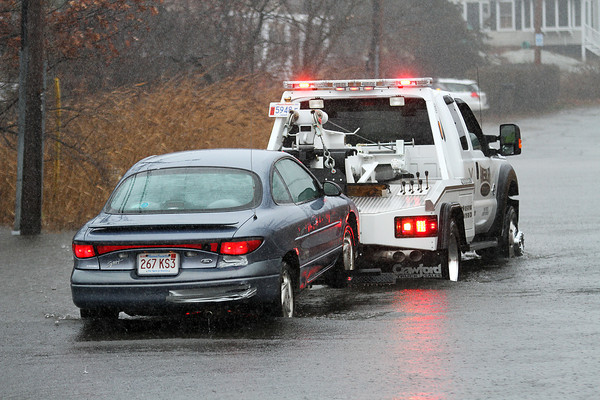 Salisbury: A car need to be towed after getting stuck in the rising water on Rings Island Thursday morning. With the heavy rain and high tide, there was flooding on Rings Island and further down on Ferry Road as well. Photo by Ben Laing/Staff Photo