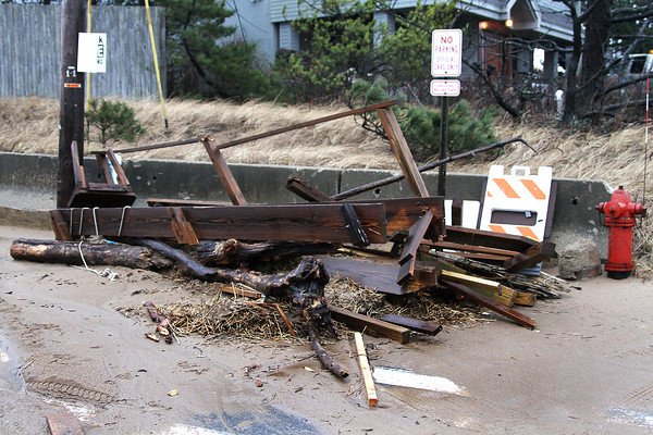 Newbury: A pile of debris was cleared from the central parking lot at Plum Island Thursday after the high tide washed over the dunes and down the street. Photo by Ben Laing/Staff Photo
