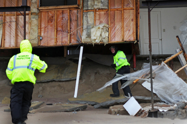 Newbury: Officials inspect damage done to a home on Annapolis Way on Plum Island Thursday afternoon. Many neighboring homes suffered from the effects of the storm that rolled through Thursday morning. Photo by Ben Laing/Staff Photo