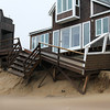 Newbury: The deck on this home along Annapolis Way on Plum Island was badly damaged during Thursday's storm, as was many neighboring homes. Photo by Ben Laing/Staff Photo