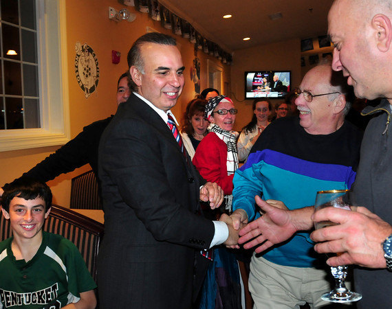 Georgetown: Lenny Mirra receives congratulations last night in his win over Barry Fogel for the seat being vacated by Harriet Stanley. Bryan Eaton/Staff Photo