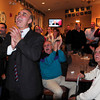 Georgetown: Lenny Mirra and supporters cheer as final numbers are posted on a bulletin board giving him the win over Barry Fogel. Bryan Eaton/Staff Photo