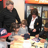 Newburyport: New England Patriot's defensive back Patrick Chung signs autographes for Jaclyn Zinck and her siblings Jillian and Jonathan as well as her parents Mary and David at the Port City Sandwich Shop Saturday morning. The event was a fund raiser for a scholarship in the name of the Zinck daughter Trista, who was killed by a drunk driver in 2003. JIm Vaiknoras/staff photo