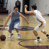 Newburyport:  Triton's Jedd Hutchins drives past Newburyport's Colby Morris during their game at Newburyport Tuesday night. Jim Vaiknoras/staff photo